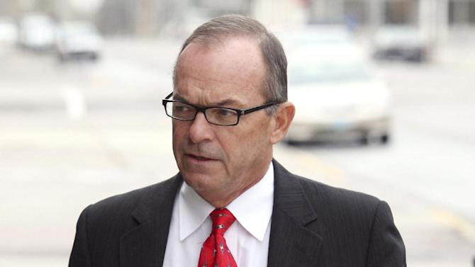 FILE - In this file photo taken April 29, 2009, Tim Blixseth arrives at the federal courthouse in Missoula, Mont. A federal appeals court has resurrected a bid by the state of Montana to force luxury resort founder Blixseth into bankruptcy to make him cough up $57 million in alleged unpaid taxes.  (AP Photo/Mike Alban, File)