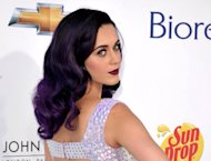 FILE - This May 20, 2012 file photo shows singer Katy Perry arriving at the 2012 Billboard Awards at the MGM Grand in Las Vegas, Nev. The pop star&#39;s energetic Day-Glo performances and chart success _ tying Michael Jackson&#39;s &quot;Bad&quot; with five No. 1 singles from her album &quot;Teenage Dream&quot; _ are undercut by heartbreak in her new 3D concert film &quot;Katy Perry: Part of Me.&quot; She sobs uncontrollably backstage as her marriage to Russell Brand falls apart during her world tour, and talks about her dashed desire for &quot;fairy tale&quot; romance. The film opens nationwide on July 5. (Photo by John Shearer/Invision/AP)