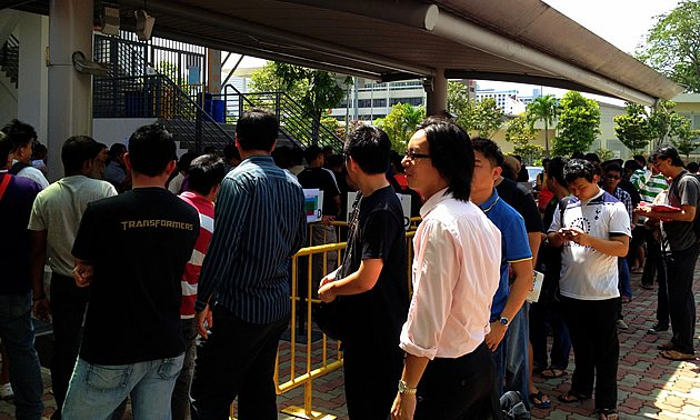 People queuing for tickets to S'pore's match against Kelantan at the Jalan Besar Stadium.