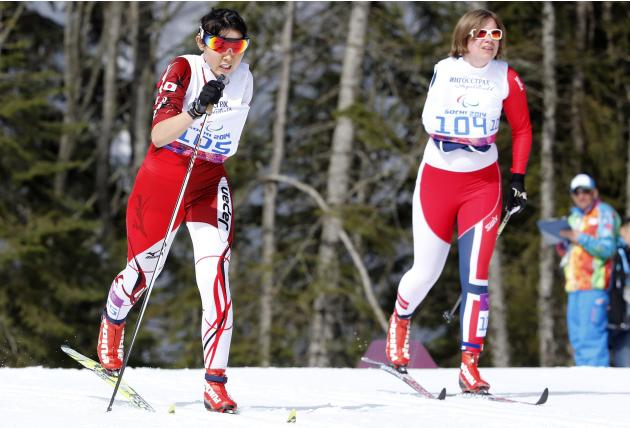 Norway's Olsen and Japan's Abe ski during the women's 15 km cross-country standing at the 2014 Sochi Paralympic Winter Games in Rosa Khutor