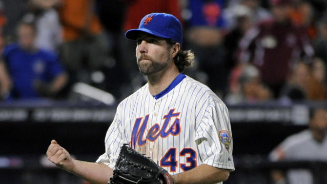 New York Mets pitcher R.A. Dickey reacts as he walks off the mound after the eighth inning of an interleague baseball game against the Baltimore Orioles, Monday, June 18, 2012, at Citi Field in New York. Dickey pitched a one-hitter as the Mets defeated the Orioles 5-0. (AP Photo/Bill Kostroun)