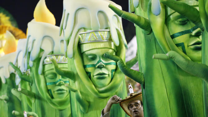 Revellers of the Mocidade samba school perform during the carnival parade at the Sambadrome in Rio de Janeiro