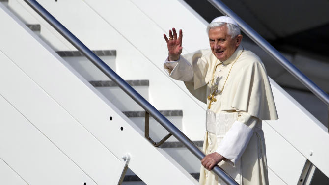 Pope Benedict XVI waves as he boards a plane on his way to a six-day visit to Mexico and Cuba, at Rome's Fiumicino international airport, Friday, March 23, 2012. (AP Photo/Andrew Medichini)