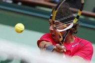 Spain's Rafael Nadal hits a return to Spain's David Ferrer during their semifinal tennis match of the French Open tennis tournament. Nadal won 6-2, 6-2, 6-1