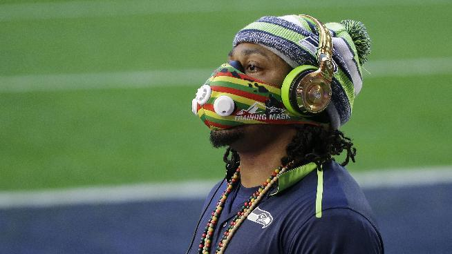 Seattle Seahawks running back Marshawn Lynch warms up before the NFL Super Bowl XLIX football game against the New England Patriots on Sunday, Feb. 1, 2015, in Glendale, Ariz
