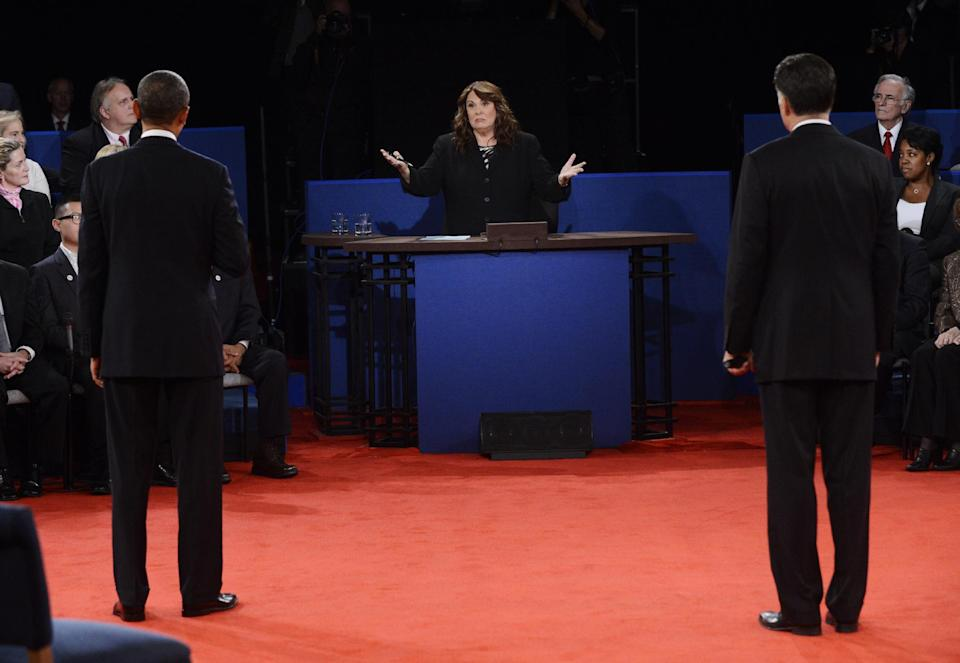 Moderator Candy Crowley, center, addresses President Barack Obama, left, and Republican presidential nominee Mitt Romney during the second presidential debate at Hofstra University, Tuesday, Oct. 16, 2012, in Hempstead, N.Y. (AP Photo/Pool-Michael Reynolds)
