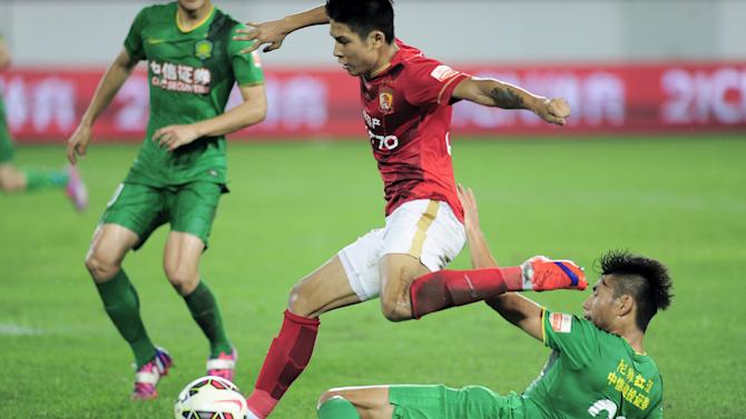Guangzhou Evergrande Taobao play against Beijing Guoan during a soccer match, in Guangzhou, Guangdong province