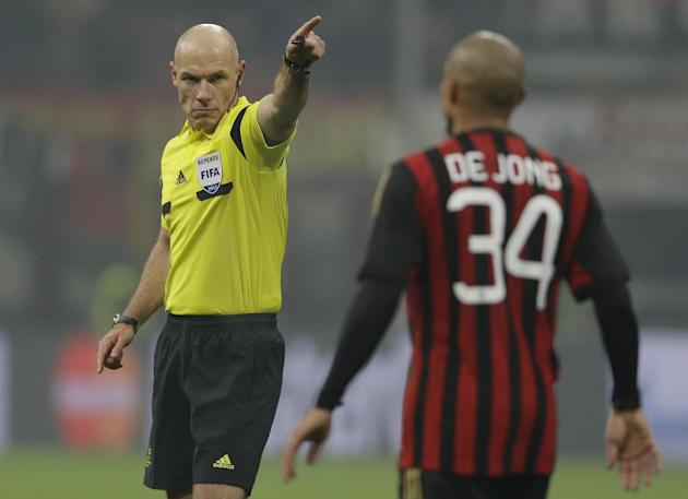 British referee Howard Webb gestures to AC Milan midfielder Nigel de Jong, of the Netherlands, during a Champions League, Group H, soccer match between AC Milan and Ajax at the San Siro stadium, in Mi