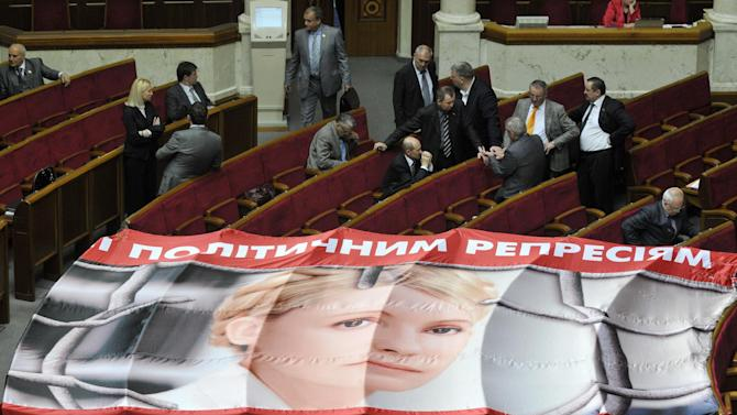 A banner placed on seats usually occupied by opposition lawmakers is used to protest against the arrest of Ukraine's former Prime Minister Yulia Tymoshenko, during a session in Kiev, Ukraine, Wednesday, April 25, 2012. Former Ukrainian Prime Minister Yulia Tymoshenko alleged on Tuesday that guards at the prison where she is being held severely beat her and said she has begun a hunger strike. (AP Photo/Sergei Chuzavkov)