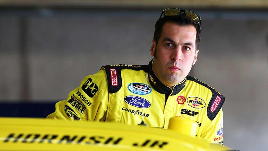 Hornish holds on after wreck