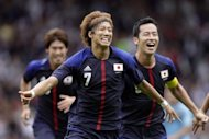 Japan's Yuki Otsu celebrates scoring a goal during the Men's Olympic football match Japan vs Spain on July 26 at Hampden Park in Glasgow, Scotland. Japan was euphoric Friday after their Blue Samurai scored a stunning 1-0 victory over champions Spain in one of the greatest upsets in Olympic football history