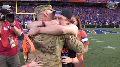 Military Dad Surprises His 4 Kids at Florida Football Game in Front of 90,000 Cheering Fans