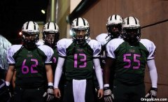 Tigard football team plays in pink uniforms