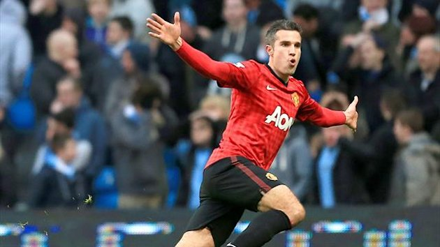 Robin van Persie celebrates scoring the winner for Manchester United against Manchester City