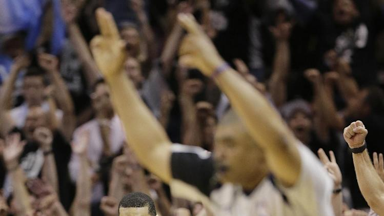 San Antonio Spurs' Danny Green (4) scores a three-point basket against the Miami Heat during the second half at Game 5 of the NBA Finals basketball series, Sunday, June 16, 2013, in San Antonio. (AP Photo/Eric Gay)