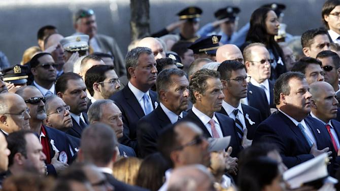 Former New York Mayor Rudolph Giuliani, far left, New York Mayor Michael Bloomberg, fifth left, New York Governor Andrew Cuomo, fourth right, and New Jersey Governor Chris Christie, second right, attend as friends and relatives of the victims of the Sept. 11 terrorist attacks on the World Trade Center attend a ceremony marking the 11th anniversary of the attacks at the National September 11 Memorial at the World Trade Center site in New York, Tuesday, Sept. 11, 2012. (AP Photo/Jason DeCrow)