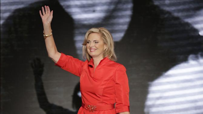 FILE - This Aug. 28, 2012 photo shows Ann Romney, wife of U.S. Republican presidential candidate Mitt Romney, waving after addressing the Republican National Convention in Tampa, Fla. Romney wore a knee-length bright red belted dress designed by Oscar de la Renta.  (AP Photo/J. Scott Applewhite)