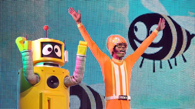 DJ Lance Rock, right, and Plex perform onstage at Yo Gabba Gabba! Live!: Get The Sillies Out! 50+ city tour kick-off performance on Thanksgiving weekend at Nokia Theatre L.A. Live on Friday Nov. 23, 2012 in Los Angeles. (Photo by John Shearer/Invision for GabbaCaDabra, LLC./AP Images)