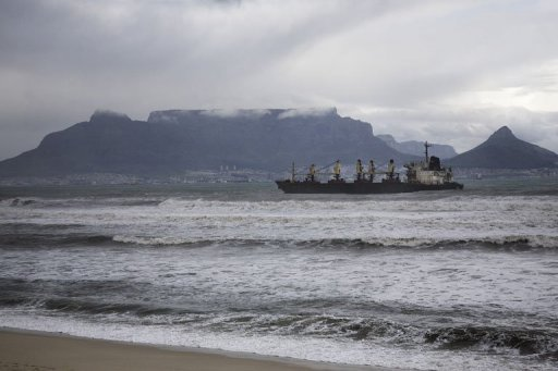 <p>A bulk carrier sits after running aground in 2009 in front of the Table Bay beach on the outskirts of Cape Town, South Africa. Oil from the Turkish bulk carrier that ran aground three years ago was spilling onto two beaches on Saturday, officials said.</p>