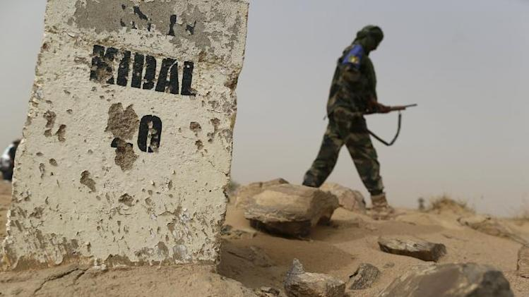 A Malian soldier patrols on a road between Gao and Kidal in northern Mali on July 26, 2013