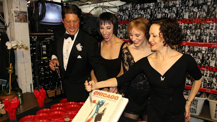 "In this photo provided by The Publicity Office, from left, ""Chicago"" cast members Christopher Sieber, Nikka Graff Lanzarone and Charlotte d'Amboise watch as original cast member Bebe Neuwirth cuts a cake Friday, Aug. 26, 2011, in New York. The cast and crew of the musical ""Chicago"" celebrated a Broadway milestone with a small backstage party at intermission, as the show marked its 6,137th performance _ tying ""A Chorus Line"" for the fourth longest-running show in Broadway history. (AP Photo/The Publicity Office,  Jeremy Daniel)"