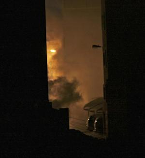 Clouds of tear gas waft through the streets of Sitra, Bahrain, on Wednesday night, Sept. 14, 2011. Clashes erupted after word of a Sitra man's death. Relatives said the man died in hospital after being repeatedly exposed to heavy tear gas used by riot police to quell anti-government protests. The official Bahrain News Agency reported, however, that Sayed Jawad Ahmad, 35, was a sickle cell patient who died after suffering Acute Respiratory Syndrome Distress. (AP Photo/Hasan Jamali)