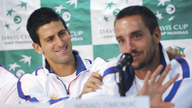 Serbia's Novak Djokovic, left, grabs the shoulders of teammate Viktor Troick as Troicki jokes about the popularity of Djokovic in Serbia and that he might be the future president of their country, Tuesday, April 2, 2013, at a Davis Cup tennis news conference Tuesday, April 2, 2013, in Boise, Idaho. Serbia and the United States meet in a Davis Cup tie this weekend. (AP Photo/Idaho Press-Tribune, Greg Kreller)
