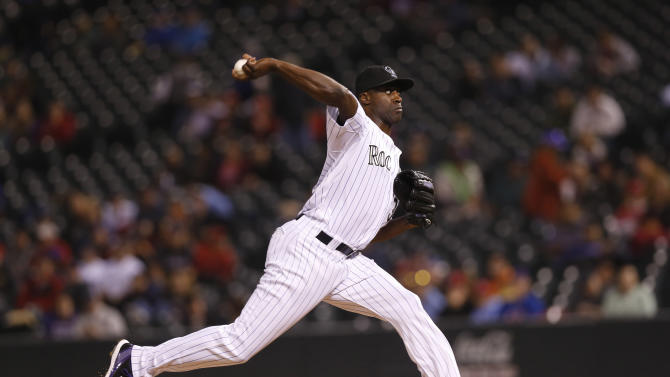 In this photograph taken Wednesday, July 8, 2015, Colorado Rockies relief pitcher LaTroy Hawkins works against the Los Angeles Angels in the seventh inning of an inter league baseball game in Denver. Hawkins was traded along with all-star shortstop Troy Tulowitzki tot he Toronto Blue Jays for four players on Tuesday, July 28, 2015. (AP Photo/David Zalubowski)