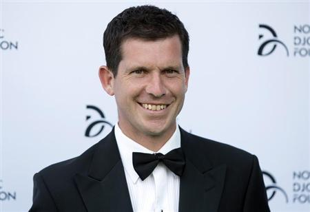 Former tennis player Tim Henman poses for photographers as he arrives at a fundraising dinner for the Novak Djokovic Foundation in London July 8, 2013. REUTERS/Neil Hall/Files