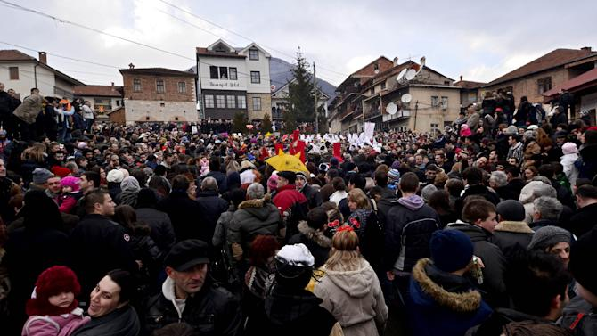 In this picture taken Sunday, Jan. 13, 2013, people crowd the main square in Macedonia's southwestern village of Vevcani during the carnival parade. Said to date from pagan times 1,400 years ago, the Vevcani carnival, with its colorful floats and masked revelers, has grown in popularity over the last decade and attracts thousands of visitors for the celebrations on St. Vasilij Day to welcome in the New Year according to the Julian calendar. (AP Photo/Boris Grdanoski)