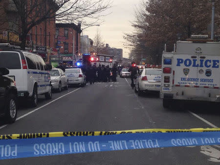 Police block off the scene of a shooting where a gunman killed two NYPD officers in New York