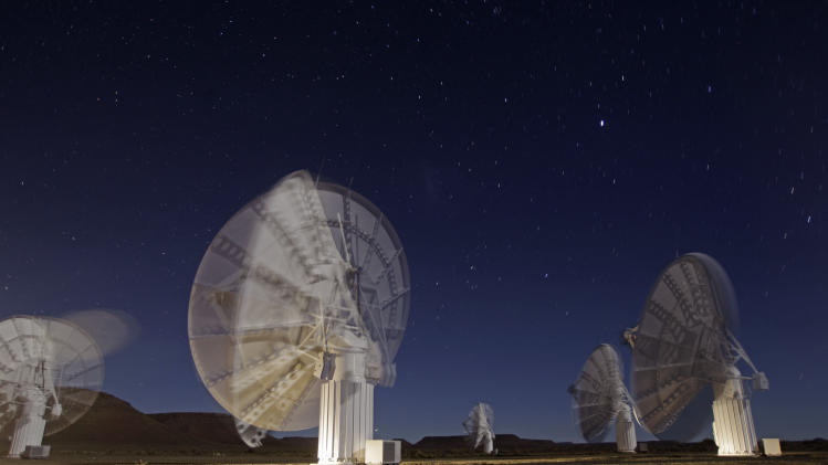 In this time exposure photo taken Monday, April 2, 2012, stars are seen above telescope dishes near the Karoo town of Carnarvon, South Africa, which is announced Friday May 25, 2012, as the site of the proposed Square Kilometre Array (SKA) radio telescope project. A giant radio telescope made up of some 3,000 separate 15-meter (49-foot) diameter dishes and intended to help scientists answer fundamental questions about the make-up of the universe will be built and based in both Australia and South Africa, the international consortium overseeing the project announced Friday. (AP Photo/Schalk van Zuydam) EDS NOTE: TIME EXPOSURE CAUSING BLUR AS TELESCOPE DISHES MOVE