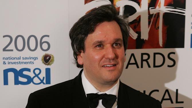 """FILE - Antonio Pappano holds the Critic's Choice Brit award at the Brit Classical Music Awards at the Royal Albert Hall in London in this Thursday May 4, 2006 file photo. Modern-day singers lack commitment and stamina compared to previous generations of performers Pappano, the music director of London's Royal Opera House, said Wednesday March 13 2013. Singers """"are either weaker in their bodies or don't care,"""" and need more periods of rest than previous generations.(AP Photo/Alastair Grant)"""