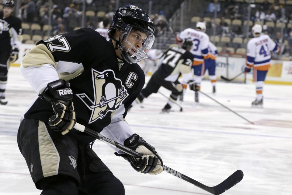 Pittsburgh Penguins' Sidney Crosby (87) warms up before Game 2 of an NHL hockey Stanley Cup first-round playoff series against the New York Islanders, Friday, May 3, 2013, in Pittsburgh. (AP Photo/Gene J. Puskar)