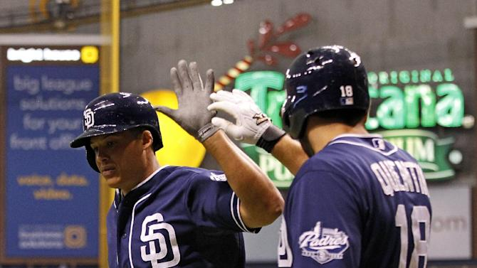 San Diego Padres' Will Venable, left, is congratulated by Carlos Quentin after his solo home run during the first inning of a baseball game against the Tampa Bay Rays, Friday, May 10, 2013, in St. Petersburg, Fla. (AP Photo/Mike Carlson)