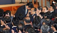 Former Japanese prime minister Shinzo Abe (top C) bows after he is named as the new Liberal Democratic Party (LDP) president at their headquarters in Tokyo on September 26, 2012. Abe won the party election to make him leader of Japan&#39;s main opposition group, a position that may put him in line to become premier at the next election