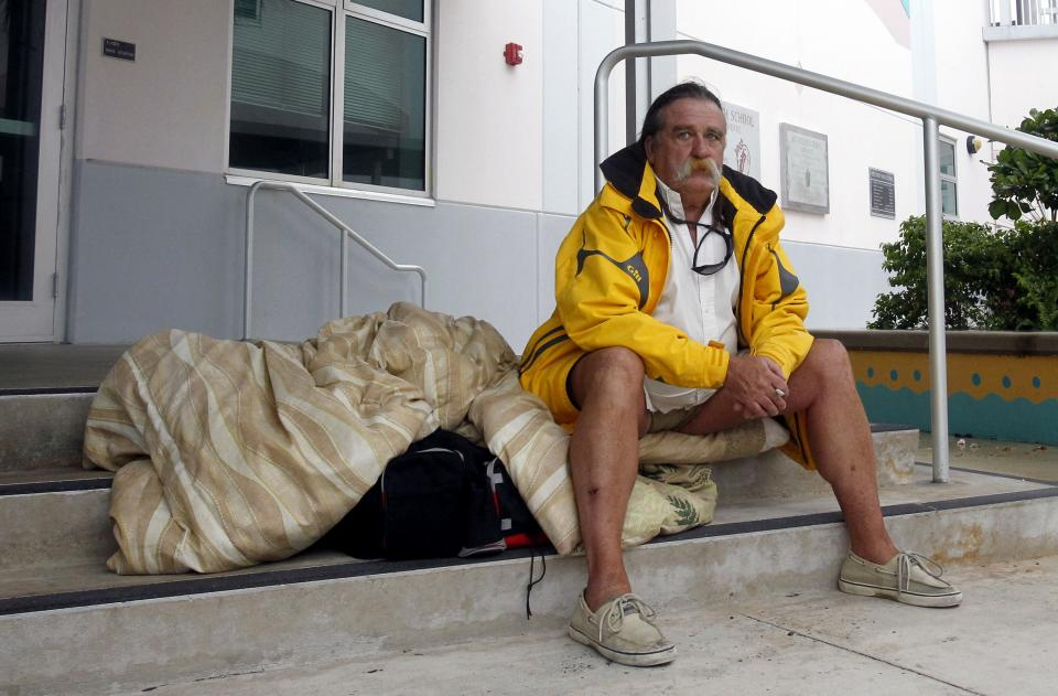 Dale Shelton waits to be taken to a shelter in Key West, Fla., Saturday, Aug. 25, 2012, as he prepares for the arrival of Tropical Storm Isaac, Saturday, Aug. 25, 2012. Isaac's winds are expected to be felt in the Florida Keys by sunrise Sunday morning. (AP Photo/Alan Diaz)