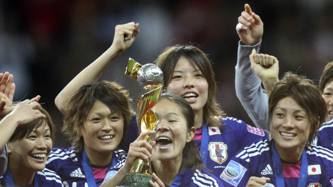 Japan players celebrate with the trophy after winning the final match between Japan and the United States at the Women's Soccer World Cup in Frankfurt, Germany, Sunday, July 17, 2011. The Japanese women's soccer team won their first World Cup Sunday after defeating USA in a penalty shoot-out. (AP Photo/Michael Probst)