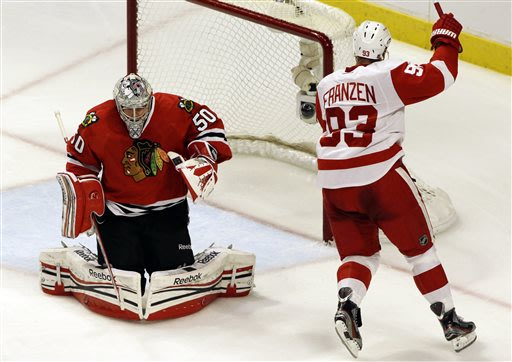 Chicago Blackhawks goalie Corey Crawford, left, reacts after Detroit Red Wings' Johan Franzen, right, scored a goal during the third period of Game 2 of the NHL hockey Stanley Cup playoffs Western Con