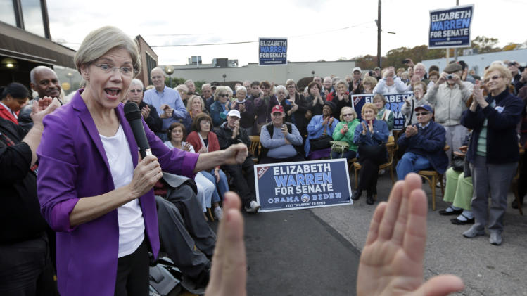Democratic candidate for U.S. Senate Elizabeth Warren, left, reacts as she is applauded during her campaign speech in Brockton, Mass., Thursday, Nov. 1, 2012. Warren is challenging Republican incumbent Sen. Scott Brown. (AP Photo/Elise Amendola)