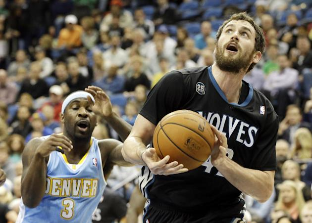 Minnesota Timberwolves' Kevin Love, right, eyes the basket in front of Denver Nuggets' Ty Lawson in the first quarter of an NBA basketball game on Wednesday, Nov. 27, 2013, in Minneapolis