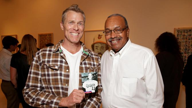 EXCLUSIVE CONTENT - PREMIUM RATES APPLY Artist Pat Riot and Former Dodgers Tommy Davis at Artist Pat Riot's Art Exhibit, 'Out of Left Field' benefiting the MLB Urban Youth Academy on Thusday, May, 23rd, 2013 in Los Angeles. (Photo by Eric Charbonneau/Invision for Protagonist Brand Management/AP Images)
