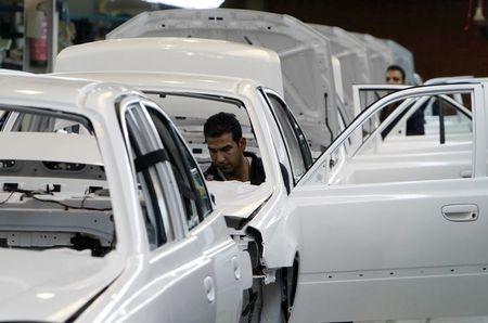 Men work in an assembly line of Hyundai cars in Egypt's biggest car assembler GB Auto in Cairo