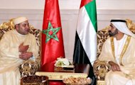 A picture provided by the official Emirates news agency WAM shows Sheikh Mohammed bin Rashid al-Maktoum, ruler of Dubai (R) meeting with King of Morroco Mohammed VI (L) in Abu Dhabi on October 22. Morocco, facing slower growth and effects of the economic crisis in European partners, aims to attract investments from the oil-rich monarchies of the Gulf