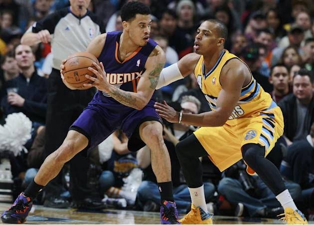 Phoenix Suns guard Gerald Green, left, looks to pass the ball as Denver Nuggets guard Randy Foye covers in the fourth quarter of the Suns' 103-102 victory in an NBA basketball game in Denver on Fr