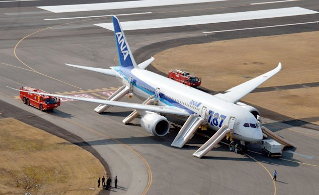 An All Nippon Airways flight sits at Takamatsu airport in Takamatsu, western Japan after it made an emergency landing Wednesday, Jan. 16, 2013. The flight to Tokyo from Ube in western Japan landed at