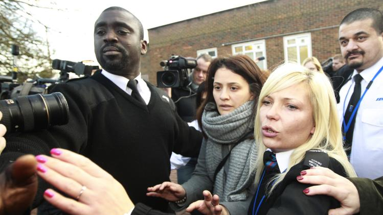 Elisabetta Grillo is escorted out of Isleworth Crown Court in west London