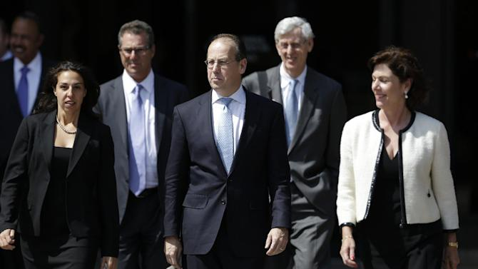 NFL lawyer Paul Clement, center, walks from the U.S. Courthouse Tuesday, April 9, 2013, in Philadelphia after a hearing to determine whether the NFL faces years of litigation over concussion-related brain injuries. Thousands of former players have accused league officials of concealing what they knew about the risk of playing after a concussion. The lawsuits allege the league glorified violence as the game became a $9 billion-a-year industry. (AP Photo/Matt Rourke)