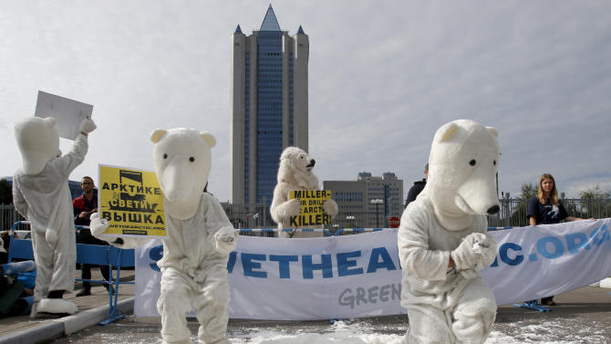 Greenpeace activists dressed as polar bears protest outside Gazprom's headquarters in Moscow, Russia, Wednesday, Sept. 5, 2012. Russian and international environmentalists are protesting against Gazprom's plans to pioneer oil drilling in the Arctic. (AP Photo/Misha Japaridze)