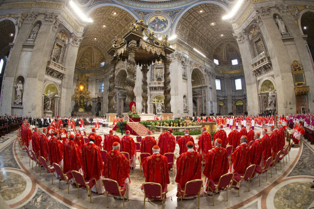 Cardinals attend a Mass for the election of a new pope celebrated by Cardinal Angelo Sodano inside St. Peter's Basilica, at the Vatican, Tuesday, March 12, 2013. Cardinals enter the Sistine Chapel on